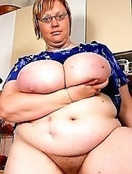 Horny mom plays with large boobs